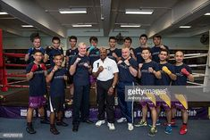 Laureus Academy Member Marvelous Marvin Hagler poses for a picture with Operation Breakthrough staffs and members at Hong Kong Police Boxing Club at. Marvelous Marvin Hagler, Boxing Club, Police Box, Hong Kong, Poses, Pictures, Photos, Photo Illustration, Resim
