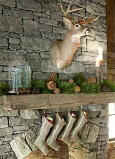 Rustic christmas, deer head, stockings by the fireplace