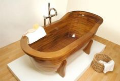 So warm and inviting.  A wooden bathtub in a rich tone.  Looks quite comfortable too.