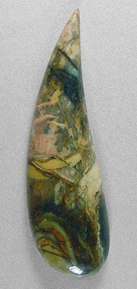 Morrisonite designer cab Silverhawk's designer gemstones.