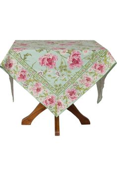 """The Rose Nouveau table cloth by April Cornell is incredibly beautiful. This one is in a glorious aqua color scheme. The pattern was delicately drawn by hand and masterfully created. It is wistful and nostalgic and utterly romantic. The light sage and dusty pink colors bloom over the fresh and cheerful aqua blue background giving your dining room a fresh and vibrant look. This washable tablecloth is made of 100% cotton. Care is machine wash in cold and tumble dry low.  Measures: 90"""" x 60""""…"""