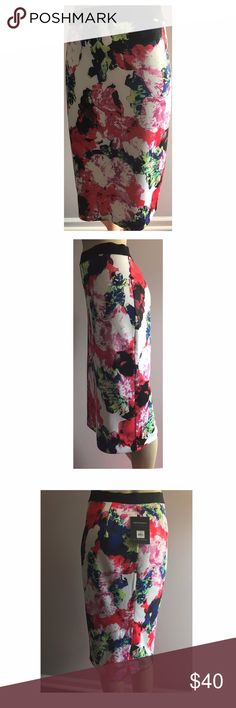 Milly floral pencil skirt PRODUCT DETAILS Fusing a floral abstract print and a sleek midi cut, this women's MILLY for DesigNation skirt gives you a contemporary look for day or night. In multi.  PRODUCT FEATURES Stretchy scuba construction Unlined FIT & SIZING 27 1/2-in. approximate length Midi length Elastic waistband Back slit FABRIC & CARE Polyester, spandex Machine wash Imported Milly Skirts Midi