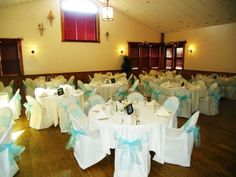 135 Chair Covers and 133 Turquoise Organza Sashes
