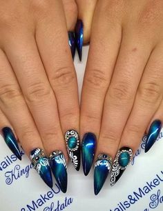 Blue, bejeweled cat eye nail manicure. These cat-eye nails are taking over social media. Click above to get 23 more cat-eye nail art designs. #cateyenails #nails #naildesigns