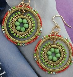 Dangly beaded earrings.  These would overwhelm my face, but I love the design.  The earrings remind me of Tibetan sacred wheels.