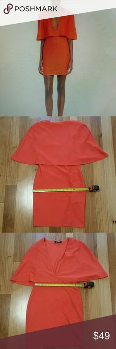 """MISSGUIDED CAPE BODYCON DRESS ORANGE SZ US 6 WORN FEW TIMES. HAS SMELL FROM PARFUM. 95% POLYESTER 5 % ELASTANE.US 6 UK 10 A CLEANLY STYLED BODY-CON DRESS GETS A DRAMATIC UPDATE FROM A POPOVER CAPE BODICE ACCENTED WITH A PLUNGING NECKLINE AND FLOUNCY ELBOW SLEEVES.SLIPS ON OVER HEAD. PLUNGING NECK . PARTIALLY LINED. LENGTH 32"""" ARMPIT TO ARMPIT APPROX 17"""" WAIST 13 """" APPROX ALL MEASUREMENTS ARE TAKING WITH THE GARMENT LYING FLAT. ??15 Missguided Dresses"""