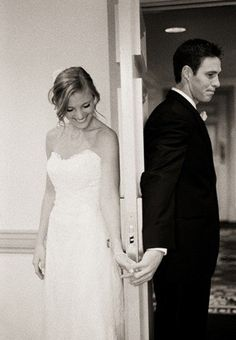 Cute! bride and groom before their wedding.  Took pictures without seeing each other (behind the door)!