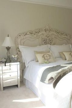I like how the headboard is fancy but blends with the wall so it's not in your face over the top fancy