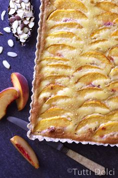 Peach Almond Tart - juicy peaches top a creamy almond filling and easy brown butter crust in this summer tart