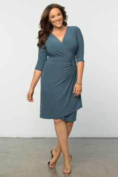 Our plus size Ciara Cinch Dress is an essential cocktail dress for every woman. Ultra-flattering and simply beautiful, this faux wrap design can work for any occasion. Browse our entire made in the USA collection online at www.kiyonna.com.