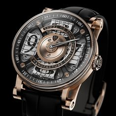 MCT Sequential Two – S200 watch. Минуты показываются единственной стрелкой, а вот часы -на четырёх блоках, состоящих из трёхсторонних призм ( как в рекламных щитах ). Текущий час - в открытом секторе.