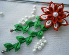 Handmade Kanzashi satin flower hair comb with falls.Each little flower measures apprx. 2.5 cm, falls length is apprx. 14 cm, with pearl embellishments.   I always use the highest quality ribbon and materials.     All hair accessories made of ribbon and satin fabric are heat sealed to prevent fraying. It is possible to make this in different colour. Just email me before ordering and let me know your requirements.    If youve got any questions, please feel free to email me.