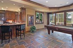 family room with slate tile floor with green blue color of Flooring Exquisite Ideas to Try in Your Family Room