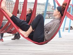 The Off-Ground Installation by Dutch designers Jair Straschnow and Gitte Nygaard provides Copenhagen's adults with a jungle gym of their own, complete with hammocks made of recycled fire hoses. #Placemaking #LQC #Upcycling