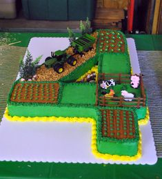 John Deere Number Birthday Cake These 20 John Deere Tractor Birthday Party Ideas are fun for any little one who loves tractors. Tractor Birthday Cakes, Number Birthday Cakes, Tractor Cakes, Tractor Cupcake Cake, Number 4 Cake, Birthday Cakes For Boys, Red Tractor, 4th Birthday Parties, Birthday Fun