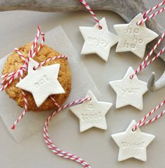 do you love to bake & make some homemade treats to give & share?  these adorable small star clay tags are a perfect touch to wrap a loaf of banana bread, box of muffins, jar of jam, bag of homebaked Christmas cookies or any little yummy treat to be shared & enjoyed!  set of 6 tags -eat, yum, enjoy, a treat, ho ho ho, sweet light linen texture with neutral imprinted words, red & white twine  each tag measures approx 4cm  my adorable little mud tags can be used to -  *tie to a gift, ...
