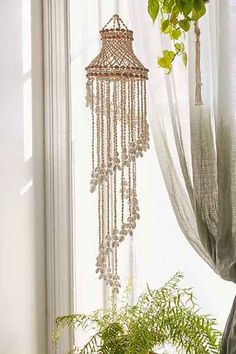 Hanging mobile in a tiered design, made from natural sea shells. Each mobile is made from unique shells and may vary slightly from the picture, giving you a one-of-a-kind piece. Macrame Design, Macrame Art, Macrame Projects, Macrame Knots, Art Macramé, Decoration, Art Decor, Shell Chandelier, Macrame Curtain