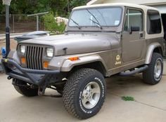 1990 Jeep Wrangler Sahara.  This is my all-time favorite Jeep model and color, though I've never owned one.