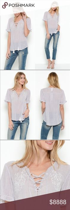 Embroidered Lace Up Top w/tassels Embroidered Lace Up Top! Short sleeve top featuring a Lace Up front design and floral embroidery. Romantic and flirty all in one! Ruffle trim sleeves. 100% Cotton,  Contrast is 100% Rayon Esley Tops Blouses