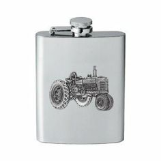 Tractor Flask by Heritage Pewter. $29.99. This 8 ounce stainless steel tractor flask is embellished with a fine pewter casting. Assembled in USA.