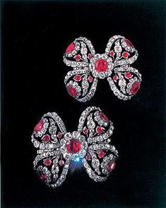 THE ROMANOVS JEWELRY ~ A pair of bows to decorate sleeves made for Catherine II of Russia. Between 1765-1767. 4.2х4.9 sm. Gold, silver, diamonds, rubies, shpinel (the same gem is on the top of grand Imperial crown of Russia). Kept in the Diamond Fund, Moscow Kremlin