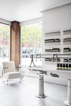 A dry cleaners on Manhattan's Upper West Side has been converted into a store for cosmetics brand Aesop, for which Tacklebox Architecture has created display shelves with profiles of upside-down clothes hangers.