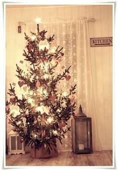 Norwegian christmas tree, I love how rustic and pretty this is! I would LOVE if our tree this year looked similar to this.