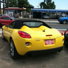 Mean Yellow Pontiac Solstice. One day I will own one of these! Hopefully.