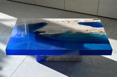 Designer Alexandre Chapelin of LA Table designed this intriguing series of three tables he refers to as Lagoon Tables. Each table is formed from a carved travertine base to which he adheres a special resin that forms volumes of water that appear to slice through each piece. The tables are undoubte