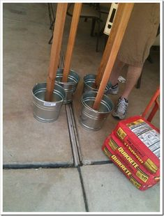 Set your light posts tiki torches etc in a bucket of concrete so they don't blow over. Set your light posts tiki torches etc in a bucket of concrete so they don't blow over. Backyard Projects, Outdoor Projects, Backyard Patio, Backyard Landscaping, Wedding Backyard, Desert Backyard, Backyard Shade, Inexpensive Landscaping, Natural Landscaping