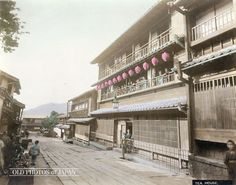 1890's. Maruyama Brothels. A view of the Nagasaki brothels Kinbaro (金波楼), the one with the lanterns, and Tamashimatei (玉島亭), the one next to Kinbaro on the far side. These were just two of many brothels in Nagasaki's Maruyama (丸山町) and Yoriai (寄合町) prostitute quarters. At the height of their popularity, Maruyama and neighboring Yoriai counted no less than 54 brothels with 766 prostitutes.