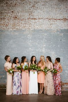 Pretty floral bridesmaids dresses really pop against a vintage industrial wedding venue! Restored Factory Wedding at Basilica Hudson in NewYork Photo by JBM Photo