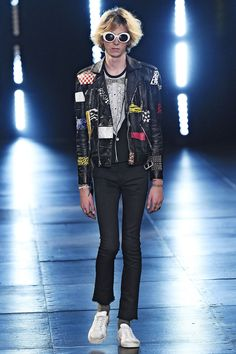 Surf culture met Hedi Slimane's disorderly strain of rock 'n' roll (with a nod to Kurt Cobain) in Saint Laurent's Spring 2016 Menswear collection. Slimane's muse, musician Julia Cumming, took to the runway, as did Dylan Brosnan (son of actor Pierce Brosnan) and Charlie Oldman (son of Gary Oldman). Meanwhile, Jane Birkin, Azzedine Alaïa, Betty Catroux and Salma Hayak Pinault watched from the front row. We're just hoping chivalry lives on with the Saint Laurent man, because we want to b...