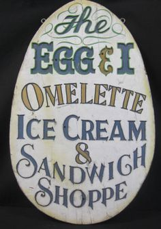 "Spectacular Antique Egg  Ice Cream Trade Sign Ca. 1900  This is one of the most beautiful signs~ It is cut out of wood with mortise  tenon joints ~The letters are Victorian in Style and made up of several different colors.  The sign itself is in the shape of an egg and advertises a shop called the Egg and I.  It measures 35"" long, 22"" wide and 1.5"" thick.  Originally from the State of Maine."