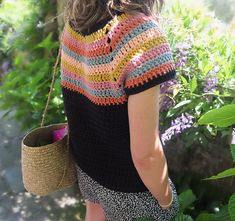 very pretty !   but no pattern...maybe you can work one on your own as it looks like very simple stitches,,just need to figure out how to do the sleeves OR you can use the color block idea on another pattern !!!