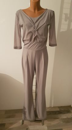 Woman Jumpsuit with braid motive and greek type back size M Chest - 42 cm Hips - 52 cm Neckline width - 30 cm From shoulder to belt - 37 cm Length - 157 cm From belt to bottom length - 112 cm Sleeve length - Bottom width - 23 cm Jumpsuits For Women, Braids, Greek, Neckline, Belt, Type, Woman, Shoulder, Trending Outfits