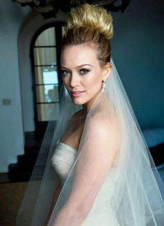 LOVE the high bun with veil underneath. LOVE Hilary Duff!
