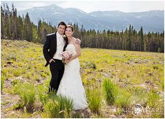 Bride and groom pose together in front of the ski resort mountain of Breckenridge, Colorado on their bright sunny summer wedding day in July. This location is found up Boreas Pass Road.  - April O'Hare Photography http://www.apriloharephotography.com #Breckenridge #Colorado #ColoradoWedding #BreckenridgeWedding #BreckWedding #BreckSkiMountain #SunnyWedding