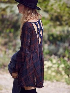 Yamaha Strappy Back Tunic | Gauzy plaid tunic with a surplice neckline, swingy skirt, and straight long sleeves with zipper cuffs. Deep V-back with grosgrain lattice strapping.
