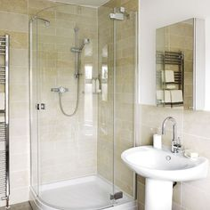 Classic small bathroom The classic styling of these bathroom fittings mean the room will stand the test of time. The white walls and neutral scheme of the room make this compact space feel bright and airy. A simple backdrop of large tiles and matching accessories adds understated class. Sink Bathstore Shower Jewson Mirrored cabinet Splash Direct Chosen by Ideal Home We used to have one like this...