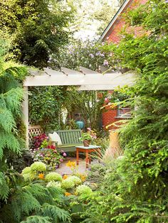 A #pergola creates a cozy nook in your garden. More pergola ideas: http://www.bhg.com/home-improvement/outdoor/pergola-arbor-trellis/add-interest-with-a-pergola/?socsrc=bhgpin041012pergola