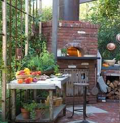 brick pizza oven - link has a bunch of awesome brick oven pictures