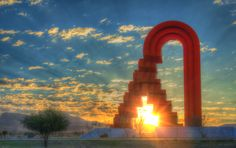 Will the Sun rise? by Víctor Puga - Sunrise at La Puerta de Chihuahua, Mexico. Colossal geometric metal composition, designed by renowned mexican sculptor Sebastian. This is one of the world's tallest sculptures (46m) and is located at the southern entrance of the city.
