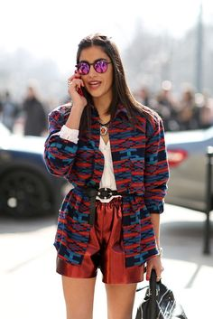 The European Guide To Flawless Style #refinery29 http://www.refinery29.com/milan-fashion-week#slide60 Mix your metals, but think outside the gold and silver family. In this case, a shiny maroon and mirrored purples look fantastic against each other.