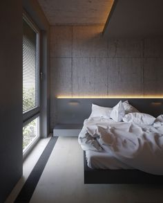 In the bedroom, granite walls behind illuminated headboards add interest without clutter. Another low-lying bed design, soft white bedding and an opaque closet partition create sensuality within close quarters.