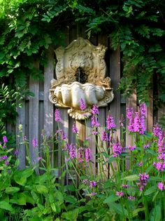 The lion's head fountain and bee balm