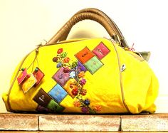 Patchwork and embroidered camvas boston bag