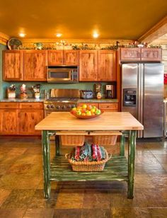Log home kitchen decorated for Christmas