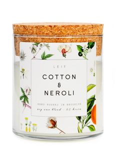 """Botanically blended candles beautifully burn with a wooden wick and a strongly scented soy wax blend. Cotton & neroli: light & airy neroli with flowering orange blossom, cotton flower & warm cedar - Soy wax blend - 21 oz glass jar with cork lid - 4"""" tall x 3.75"""" wide - 60 hour burn time - Hand poured in Brooklyn"""