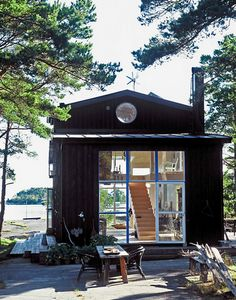 This original Swedish cottage makes me wish I could be there right now. right on the lake, almost totally transparent...love it